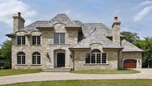 Luxury stone home with arched entry way